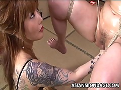 Chinese bondage babe is fisted