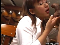 Japanese young Eri Yukawa gives hand job over her tits