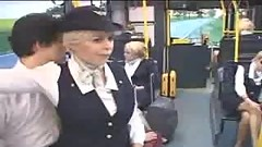Busty German hostess giving handjob in the bus