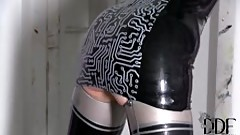 Latex Lucy is chained by the girl and mouth-fucked by big dildo